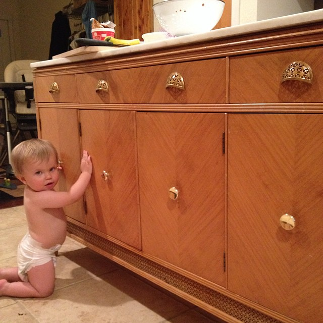 Checking out mommys new kitchen island. It's a perfect fit!