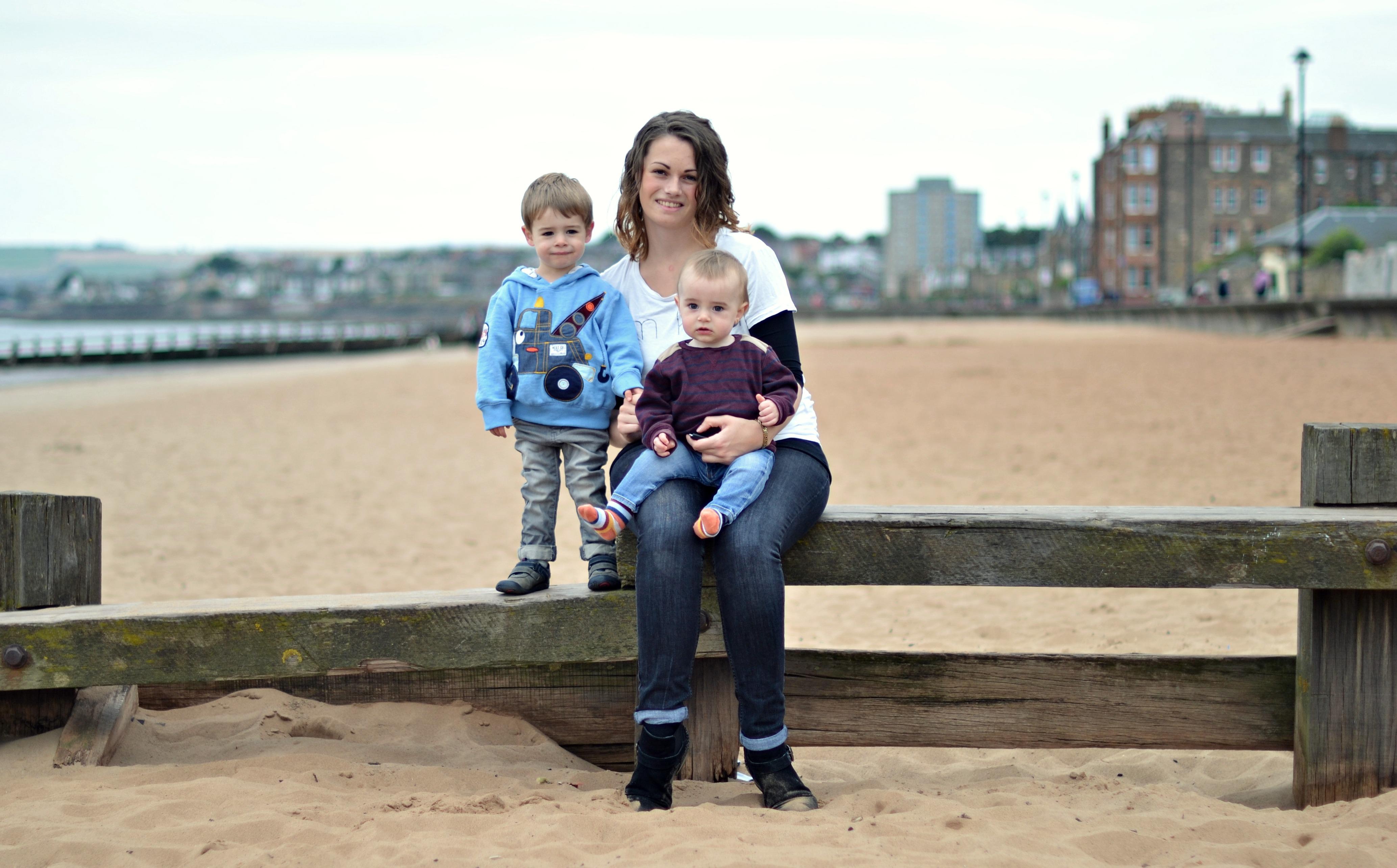 Mummy with toddler John & baby David on Portobello beach.