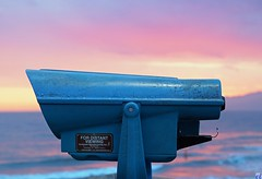 """For Distant Viewing"" is the label on three spyglass viewers on the Venice Pier, CA. Distant views indeed."