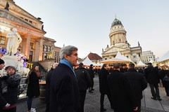 U.S. Secretary of State John Kerry walks through the Gendarmenmarkt, billed as the top Christmas market in Berlin, Germany, on December 5, 2016, before a bilateral meeting with German Foreign Minister Frank-Walter Steinmeier, and his receiving the Order of Merit from the German government. [State Department photo/ Public Domain]