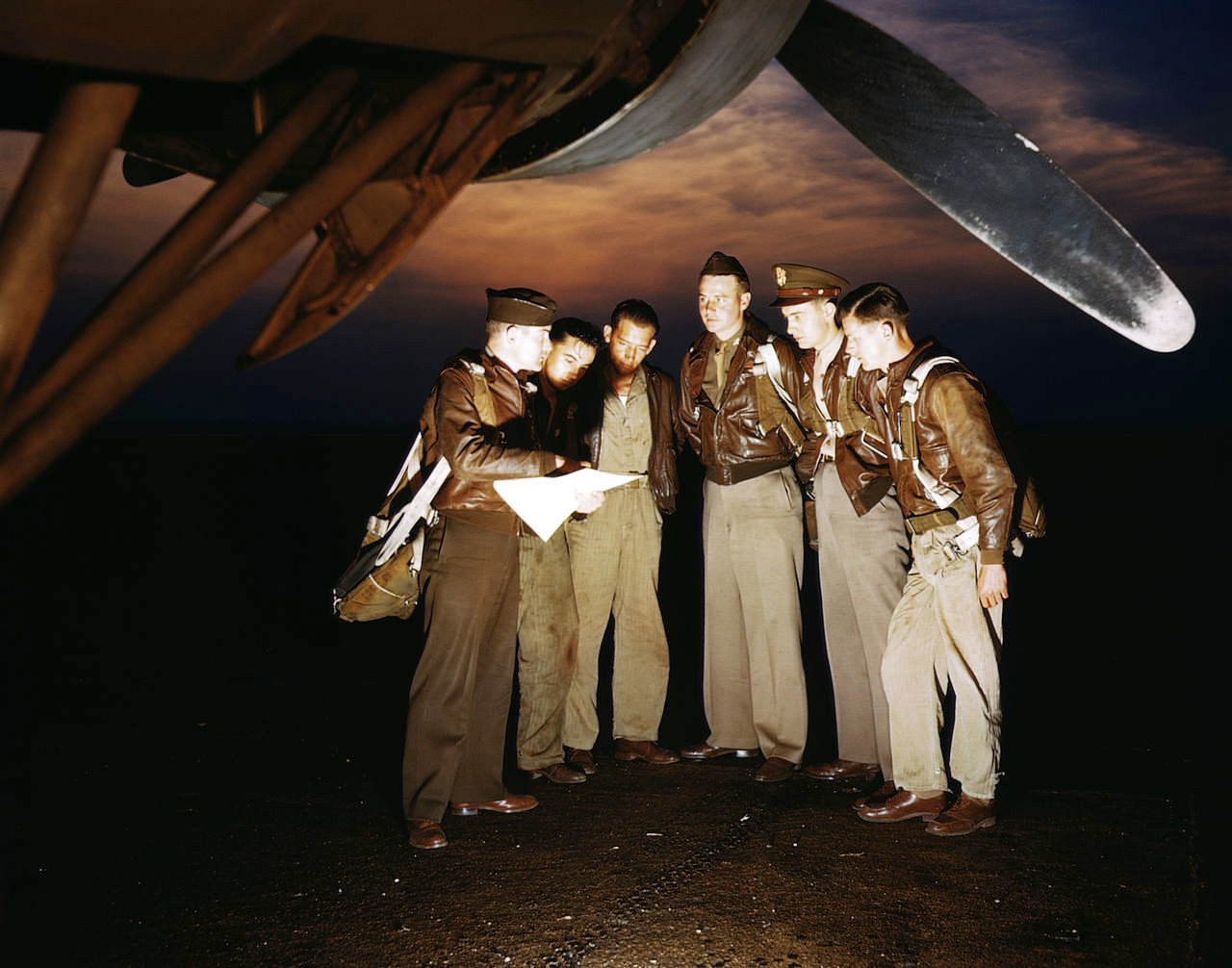 A combat crew receives final instructions just before taking off in a YB-17 bomber from a bombardment squadron base at the field, Langley Field, Va.