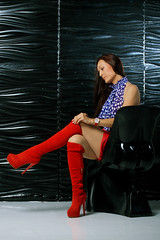 Red overknee boots on high heels, red mini skirt