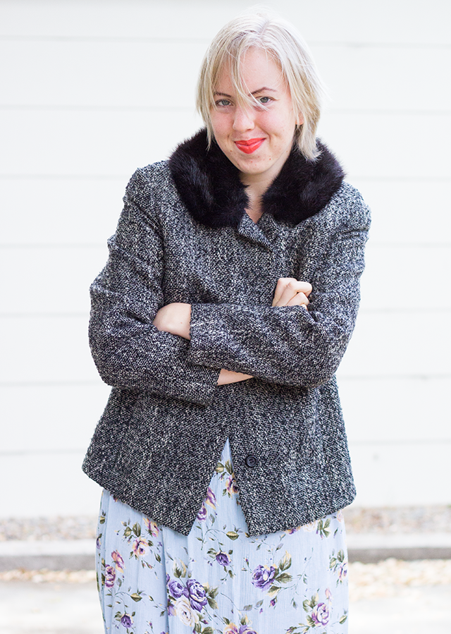 vintage grey jacket with black fur collar, mint green floral dress, bright orange lipstick