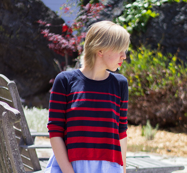 loose sweater, navy blue and red stripes of alternating widths