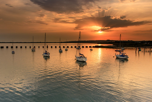 uk sunset seascape clouds reflections boats nikon haylingisland relaxing july peaceful hampshire filter lee nd yachts breeze grad southcoast sunbeams humid d800 waterscape cloudburst 2014 2470mm langstoneharbour sunsetsnapper