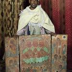 Antique Paintings and Ethiopian Priest at Yemrehana Kristos Church - Lalibela, Ethiopia