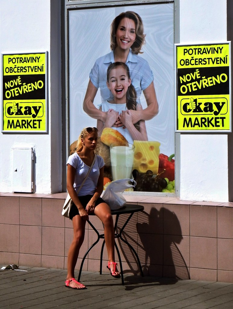 Young Woman in front of Newly Opened Shop