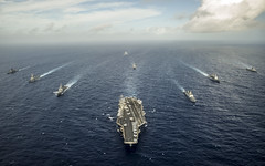 In this file photo, ships from the USS George Washington (CVN 73) Carrier Strike Group, Indian Navy and Japan Maritime Self-Defense Force steam in formation during Malabar 2014. (U.S. Navy/MC3 Chris Cavagnaro)