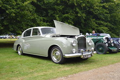 rolls-royce(0.0), rolls-royce phantom vi(0.0), rolls-royce phantom v(0.0), rolls-royce silver dawn(0.0), touring car(0.0), convertible(0.0), automobile(1.0), bentley s2(1.0), vehicle(1.0), bentley s1(1.0), rolls-royce silver cloud(1.0), compact car(1.0), antique car(1.0), sedan(1.0), classic car(1.0), vintage car(1.0), land vehicle(1.0), luxury vehicle(1.0),