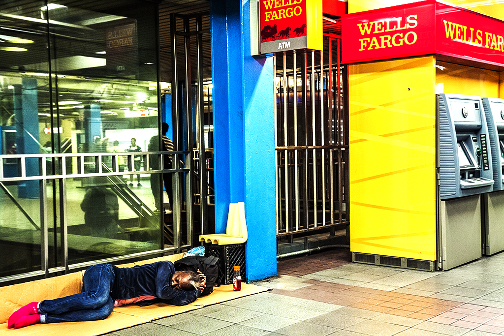 Woman-sleeping-next-to-Wells-Fargo-ATM-in-7-14--New-York