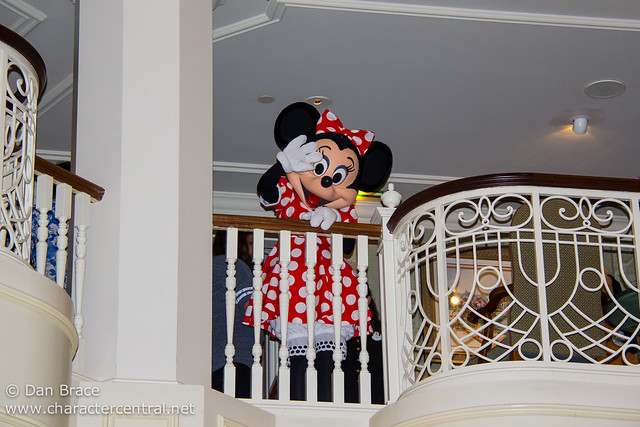 Minnie waves from the Castle Lounge