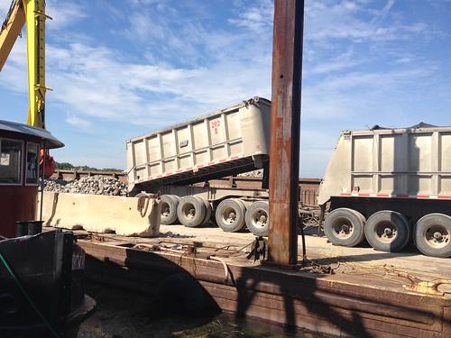 Truck unloading rock