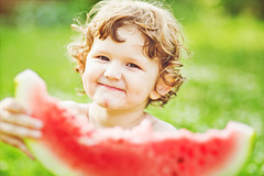 Happy child eating watermelon in summer park. Inst…