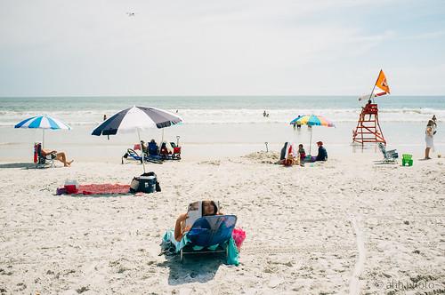 florida fujifilm jacksonville x100 beach lifeguard magazine people reading beauty ocean umbrellas fav10