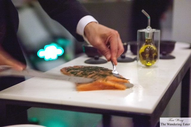 Table gets tableside service of sliced fresh lox