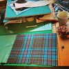 My workstation just now. Organised chaos. Anderson tartan.