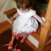 Attempting to try on someone else's shoes yesterday, minutes before she decides to taste them instead.