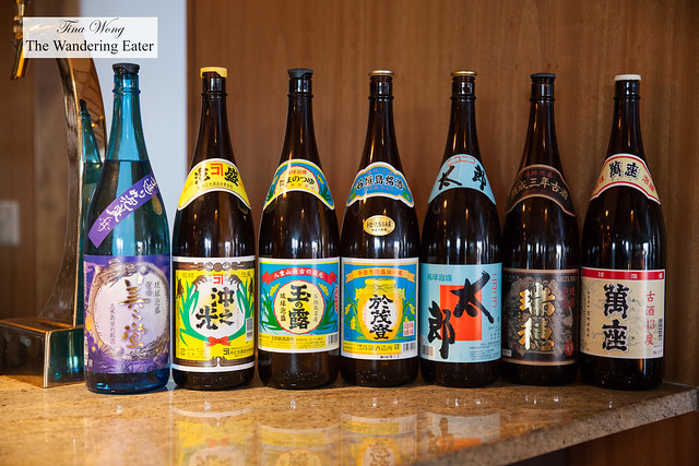 Bottles of sakes lined up