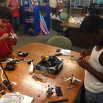 Camryn and Omar fixing r/c helicopters...almost done!
