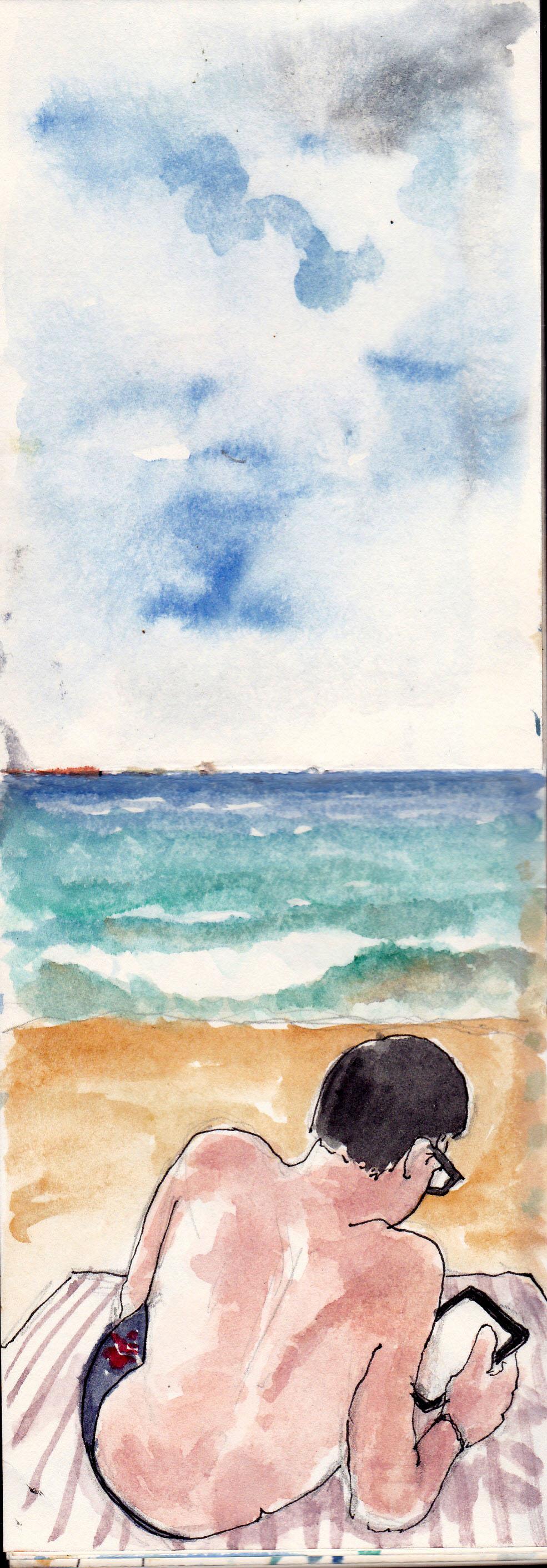 lector en la playa de Zarautz