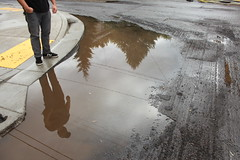 floor(0.0), soil(0.0), rain(0.0), flooring(0.0), asphalt(1.0), sidewalk(1.0), puddle(1.0), water(1.0), reflection(1.0), road surface(1.0),