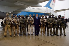 U.S. Secretary of State John Kerry poses with masked members of a tactical team at Hamburg International Airport in Hamburg, Germany, on December 8, 2016, after he attended a meeting of the Organization for Security and Co-operation in Europe hosted by German Foreign Minister Frank-Walter Steinmeier. [State Department photo/ Public Domain]
