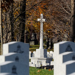 The Cross of Sacrifice in the Veteran Field of Honor glimpsed from the National Military Cemetery of the Canadian Forces (Section 103) in Ottawa, Ontario