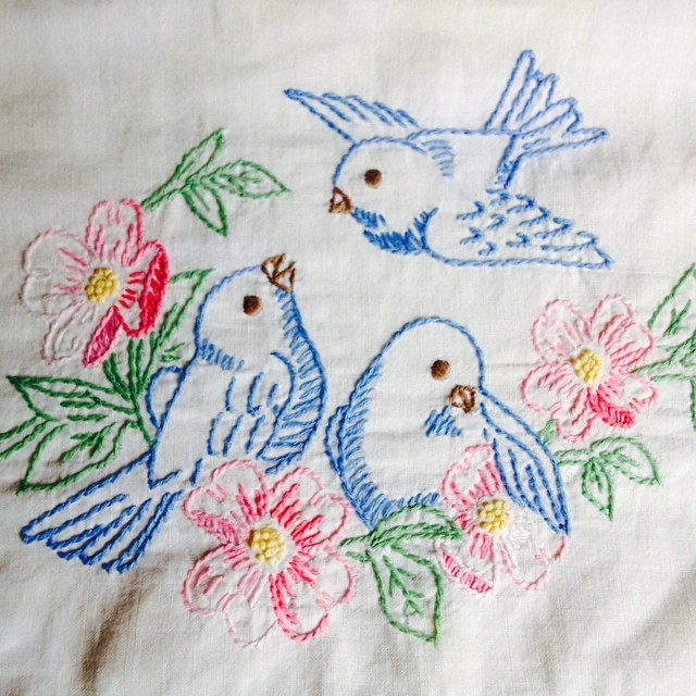 Embroidery done by my great-grandma, hanging in my mom's studio. Grandma knew how to put a bird on it.   (Also used in Mom's logo: bluebirdlegacy on Etsy).
