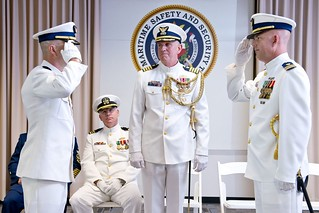 Lt. Cmdr. Chad Holm salutes Lt. Cmdr. Steve Morris as responsibility to command the unit is transferred to Morris during a change-of-command ceremony for Maritime Safety and Security Team 91104 in Galveston Thursday, July 24, 2014. Morris and his wife are Houston natives; he joined the Coast Guard at the recruiting station in Houston and went to Hastings High School in Alief Independent School District. (U.S. Coast Guard photo by Petty Officer 1st Class Andrew Kendrick)