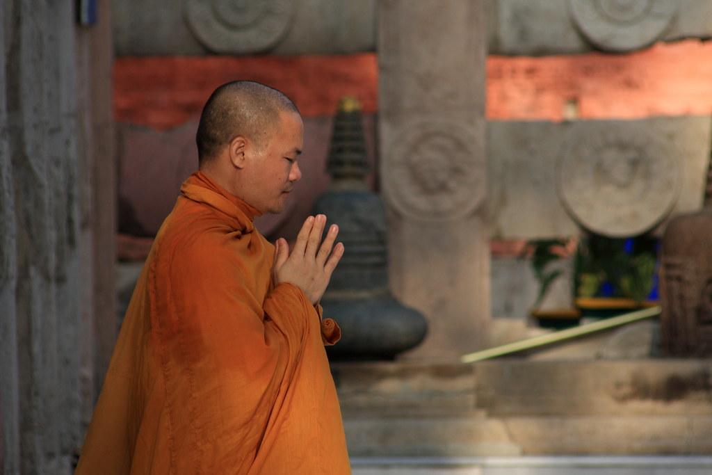 A Buddhist Monk In Prayer At The Mahabodhi Temple