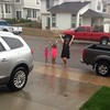 The girls playing in the rain.