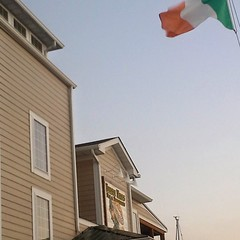 The Irish Eyes pub with the Irish flag in Lewes, DE
