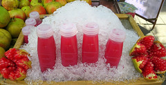 Freshly squeezed pomegranate juice for sale.