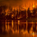 Courtney Fire reflected in Bass Lake by Darvin Atkeson