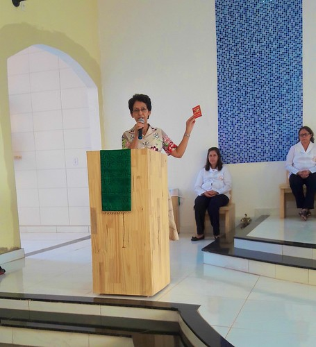 Elenice Natal de Lima SSL talks to parishioners about the purpose and mission of the Aids Pastoral Ministry and the importance of HIV testing for prevention and care of health at the Immaculate Conception Church Mass