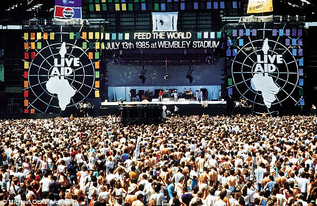 view of one of the many concerts put on for the Live Aid movement that promised much but achieved  little