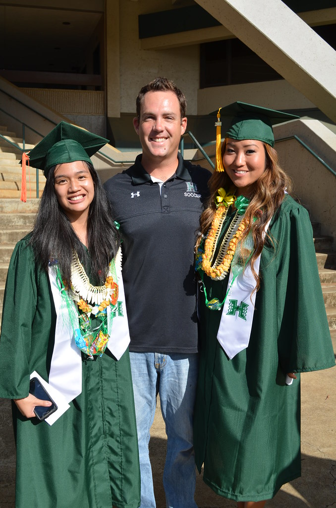 """<p>Soccer student-athletes Erika """"Storm"""" Nana and Skye Shimabukuro with assistant coach Mike Herman. They received their degrees at the University of Hawaii and Manoa commencement ceremony at the Stan Sheriff Center on May 17, 2014.</p>"""