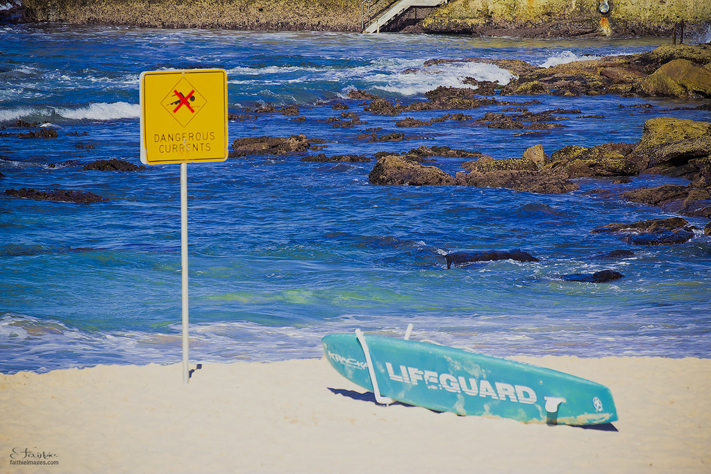 lifeguard surfboard and danger sign