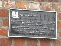 Photo of James Reynolds, W. C. Lucy, and Albert Warehouse black plaque