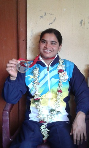 Sakina Khatun Indian Bronze winner in CW games shows her medal in her village