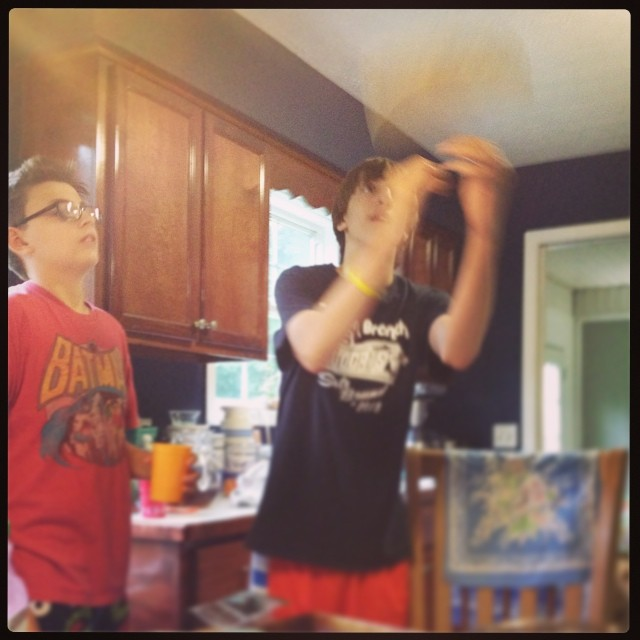 We stand in amazement at Troy's pizza skillz. #lilbros #notsolittle