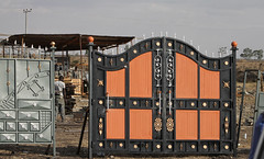 outdoor structure(0.0), fence(0.0), stall(0.0), shipping container(0.0), gate(1.0), iron(1.0),