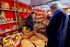 U.S. Secretary of State John Kerry looks at olive wood wares as he walks through the Weisser Zauber 'White Magic' Christmas market on December 7, 2016, while visiting Hamburg, Germany, to attend a meeting of the Organization for Security and Co-operation in Europe. [State Department photo/ Public Domain]