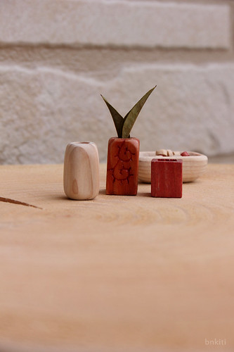 Tiny wood vases
