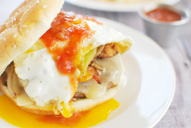 Colorado Omelet Burgers - everything you love about a Colorado Omelet as a burger. Bacon, sautéed green peppers and onions, white cheddar cheese, and a yolky egg on top. And then you pour salsa all over it.
