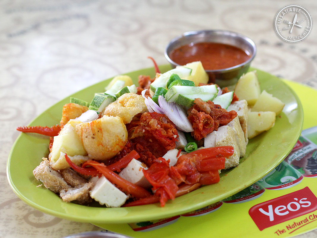 Difference from the regular rojak with shrimp paste, this rojak features deep fried dumplings, tender cuttlefish, fried shrimp, whatever else you choose, and warmed chilli sauce.