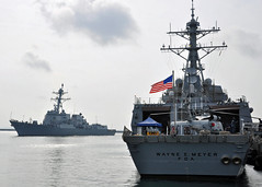 USS Halsey (DDG 97), left, arrives July 28 as USS Wayne E. Meyer (DDG 108) sits moored along the pier at Changi Naval Base. (U.S. Navy/MCC Kimberly R. Stephens)