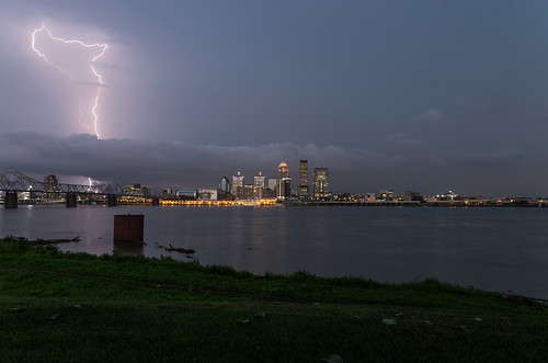 thunder lightning strike bolt skyline buildings river banks grass water clouds bridge dramatic weather storm louisville kentucky night digital