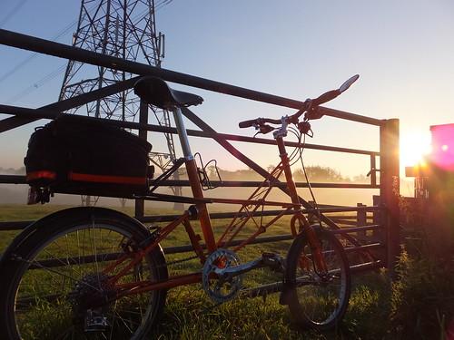 morning orange sun bicycle sunrise gate pylon explore commute commuting moulton tsr brookssaddle carradice spaceframe tsr27 moultonbicyclecompany