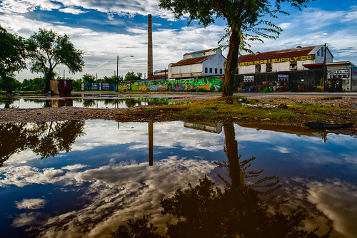 usa cloud reflection tree water austin puddle texas unitedstates tx smokestack